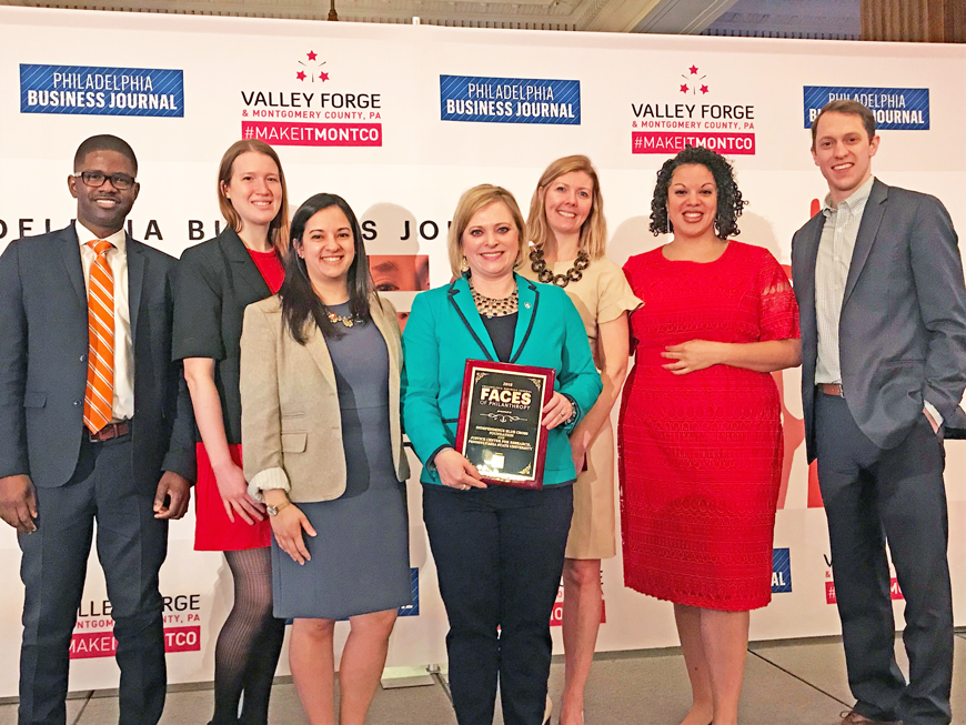 The Independence Blue Cross Foundation team with Heather Winfield, Penn State University, center, holding plaque, and Tiffany Taverez of Wells Fargo, second from right.