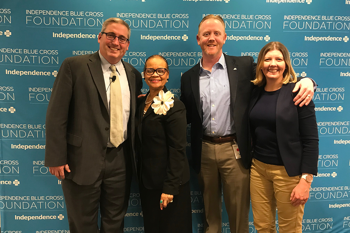 A photo of Dr. Michael McCormick of Caron Treatment Centers, Lorina Marshall-Blake of the IBC Foundation, Sean Lavelle of Caron Treatment Centers, and Heather Major of the BC Foundation programs.