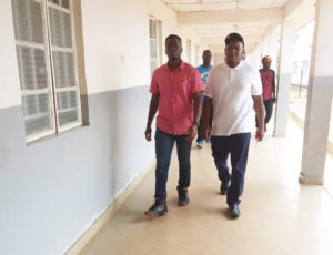 Maila and Sheku touring Magburaka Government Hospital with media crew.